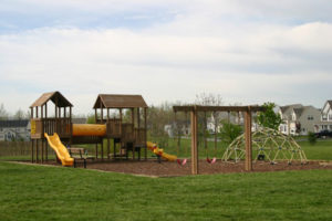Slides, a jungle gym, and a swingset at a neighborhood playground in Charles Town, WV.
