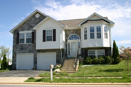 A two-story house in Charles Town, WV with a grassy lawn, two-car garage and bay window.