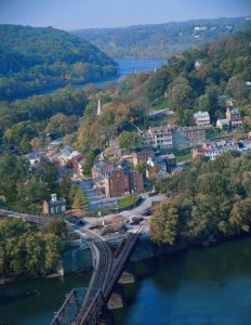 Aerial view of Harpers Ferry, WV village and railroad.