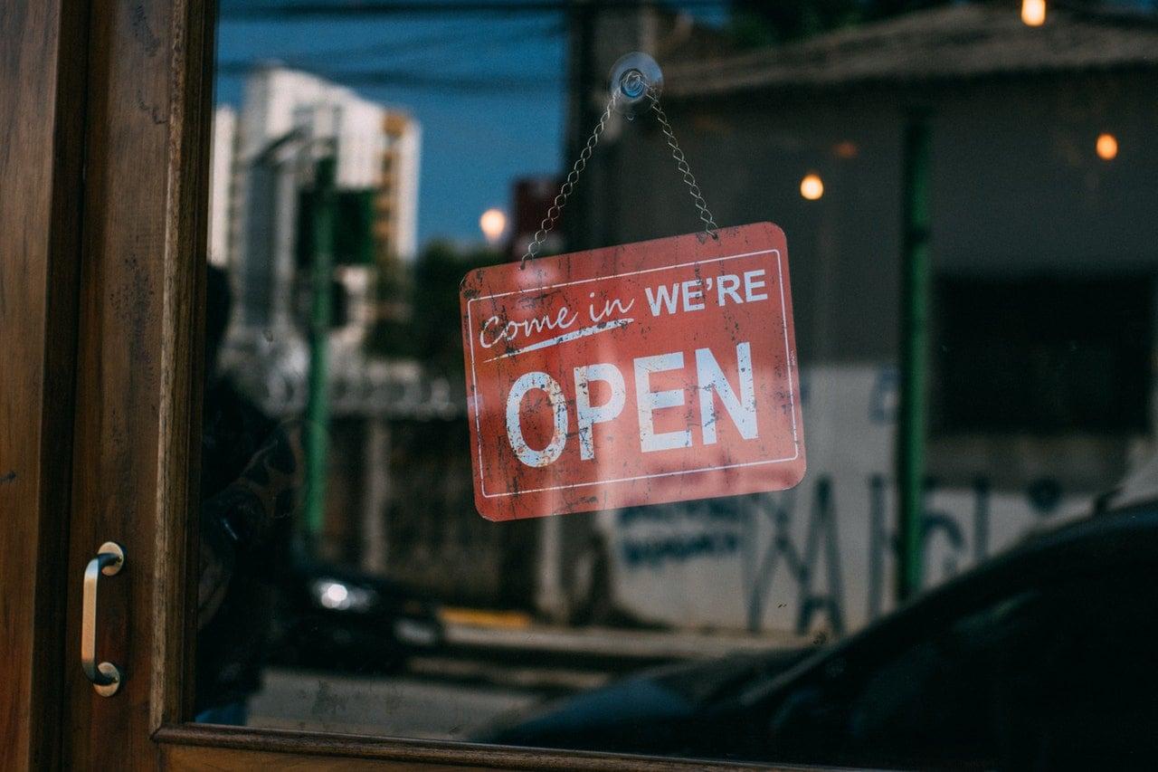 "Vintage ""We're Open"" sign."