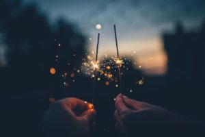Two people holding sparklers.