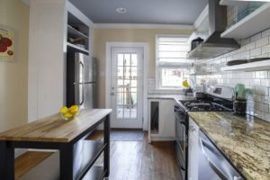 A clean and bright kitchen with a granite countertop.