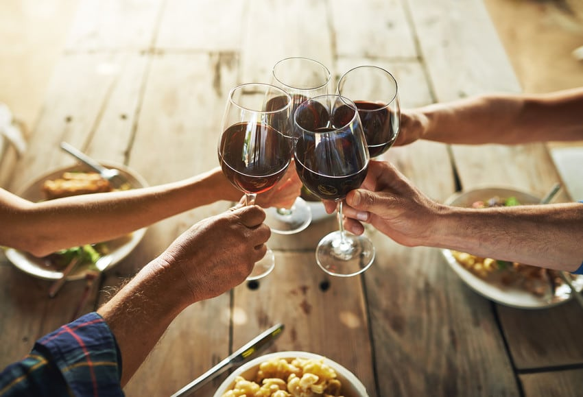 Friends drinking wine together.