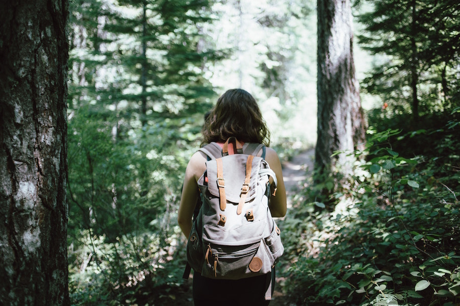Woman with backpack on hiking trail