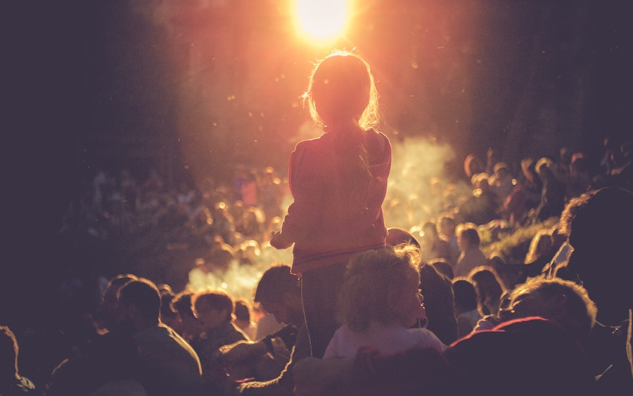 Child in crowd at night