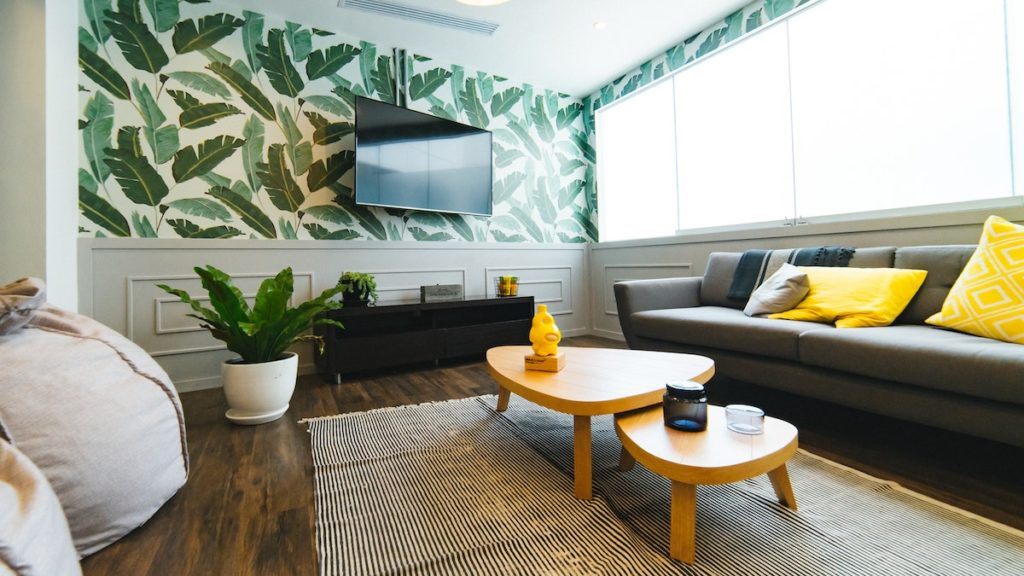 Wallpaper in a living room, and other ways to renovate your home before you sell